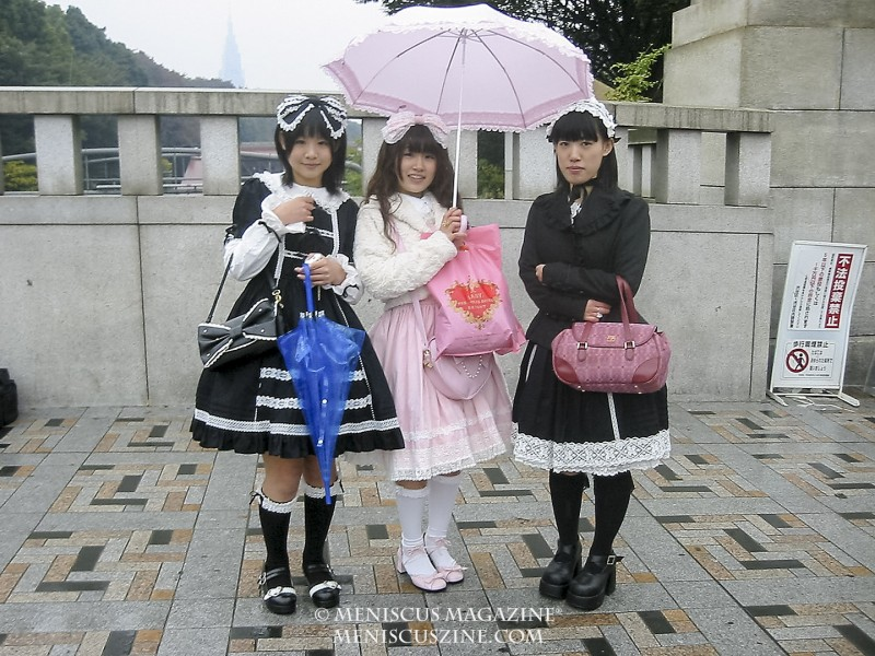If one wanted to photograph subjects in Harajuku, he or she simply had to ask. Not every request is granted. The girl in the middle is holding a shopping bag from the label Baby, The Stars Shine Bright, a Shibuya-based Lolita fashion company that has expanded overseas. (photo by Yuan-Kwan Chan / Meniscus Magazine)