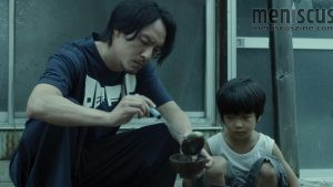 "Chang Chen as Long and Bai Run-yin as Jun in ""Mr. Long."" (still courtesy of the Tribeca Film Festival)"