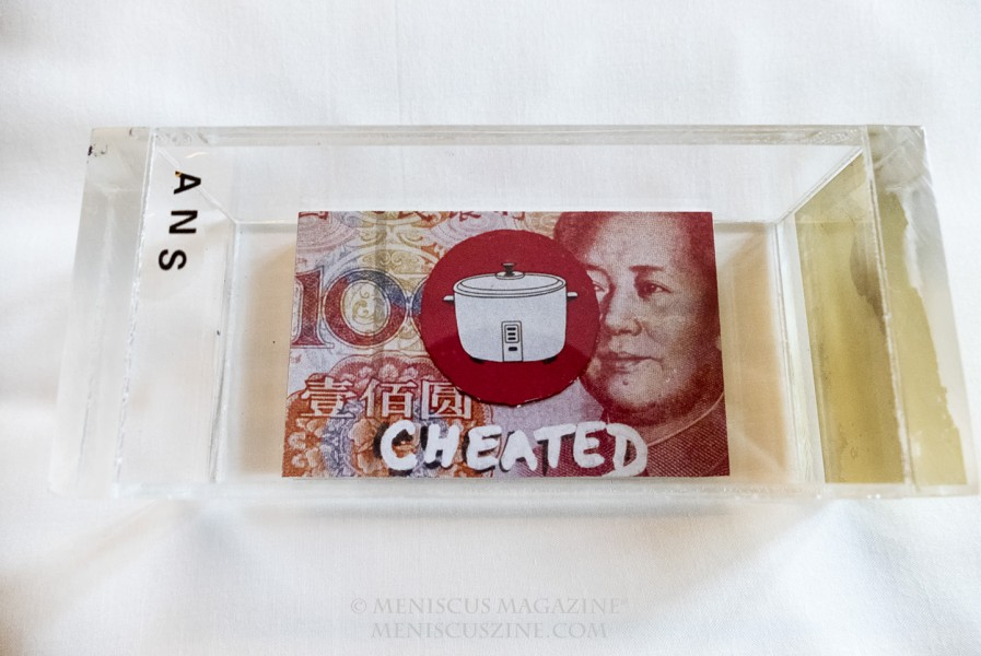 Artist: Philip Hemnell Cheated (2016) Counterfeit 100 Yuan note, business card, marker 8 cm x 5 cm x 0.2 cm (photo by Yuan-Kwan Chan / Meniscus Magazine)