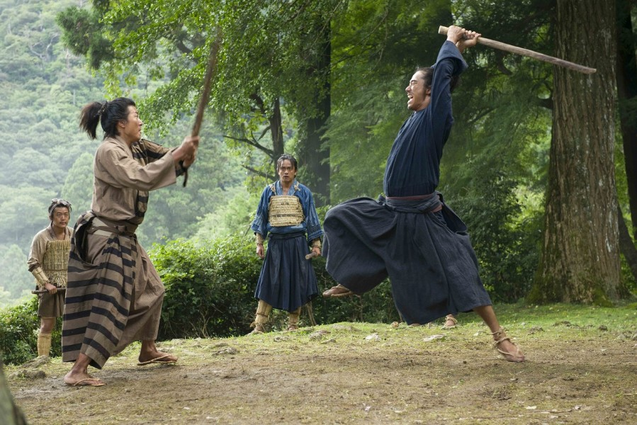 "Shinpei (right, played by Naoki Kobayashi) partakes in battle while Gosuke (Sho Aoyagi), center) observes in ""Tatara Samurai."" (still courtesy of Eleven Arts)"