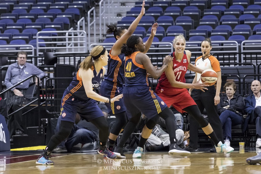 Three Connecticut players try to stop Elena Delle Donne, who had an off shooting night until the last minute of the game. (photo by Kwai Chan / Meniscus Magazine)