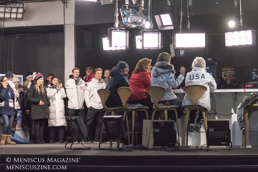 The view of the PyeongChang 2018 set from a spectator's perspective. Employees and athletes wait in the wings while the hosts switch between candid conversation, teleprompters and screens with video footage. (photo by Yuan-Kwan Chan / Meniscus Magazine)