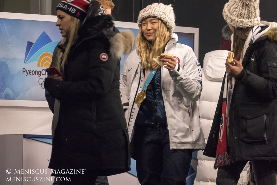 Chloe Kim, the 2018 women's snowboard halfpipe gold medalist, after her apparance on the Today Show - and still eating one of the sandwiches from a food platter presented to her on air. (photo by Yuan-Kwan Chan / Meniscus Magazine)