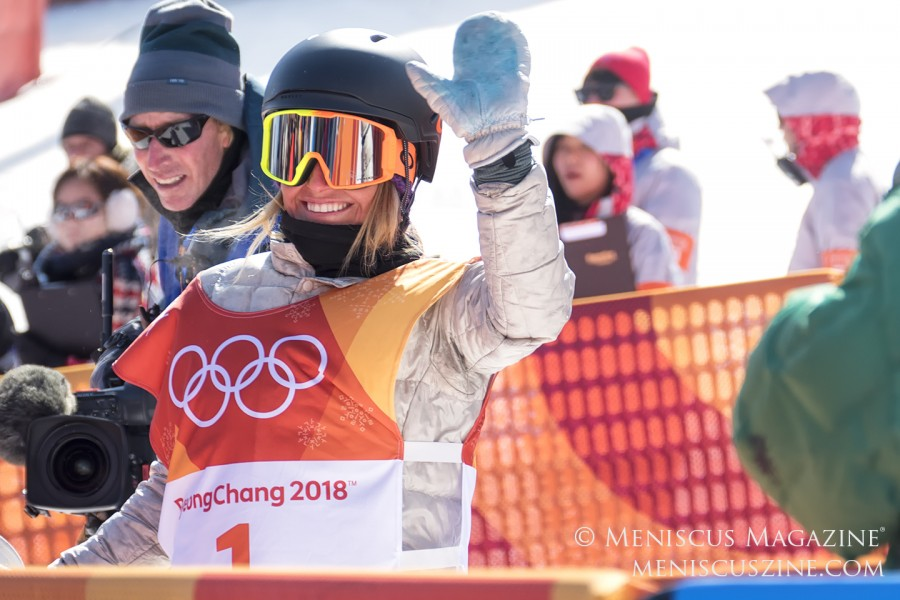 Jamie Anderson acknowledges fans after her score of 83.00 is posted, good enough for her second Olympic title. (photo by Yuan-Kwan Chan / Meniscus Magazine)