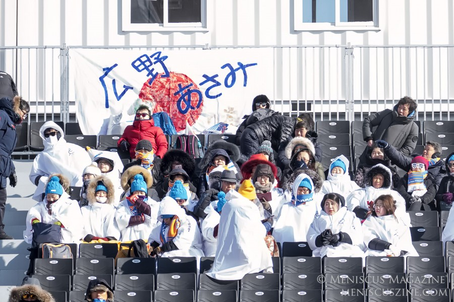 Team Japan fans try to stay warm in the bleachers at Bokwang Phoenix Snow Park. (photo by Yuan-Kwan Chan / Meniscus Magazine)