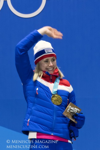 Raghnild Haga of Norway acknowledges the crowd at the PyeongChang Olympic Plaza after receiving her gold medal on Feb. 15, 2018.