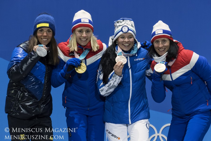 (left to right) Silver medalist Charlotte Kalla of Sweden; gold medalist Ragnhild Haga of Norway; and Krista Parmakoski (Finland) and Marit Bjoergen (Norway) who tied for the bronze.