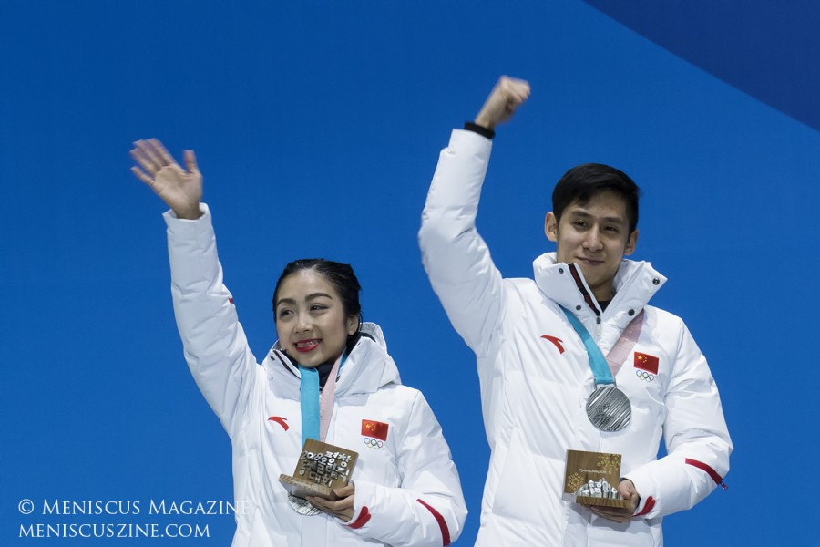 Sui Wenjing (left) and Han Cong with their silver medals. They were the reigning world champions and in first place heading into the free skate. Sui was competing in PyeongChang with a stress fracture in her right foot.