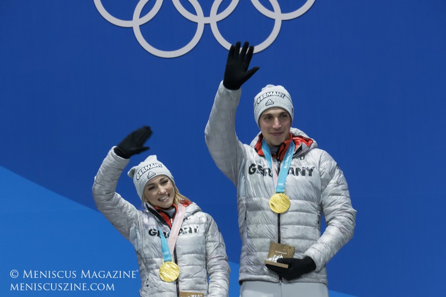 With previous partner Robin Szolkowy, Aljona Savchenko won two Olympic bronze medals in 2010 and 2014, as well as multiple world and European championships. Szolkowy's retirement led to Savchenko's partnership with Bruno Massot and another shot at Olympic gold. Just a month later in Milan, the pair won their first world championship, setting world record scores in both programs. Last week, it was announced that two-time U.S. pairs champions Alexa Scimeca-Knierim and Chris Knierim will train with Savchenko and her team, splitting their time between the States and Germany.
