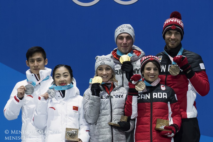 (left to right) Silver medalists Han Cong and Sui Wenjing of China; gold medalists Aljona Savchenko and Bruno Massot of Germany; and bronze medalists Meagan Duhamel and Eric Radford of Canada at the medal ceremony for the Pairs Skating event at the 2018 Winter Olympics on Feb. 15 at the PyeongChang Olympic Plaza.
