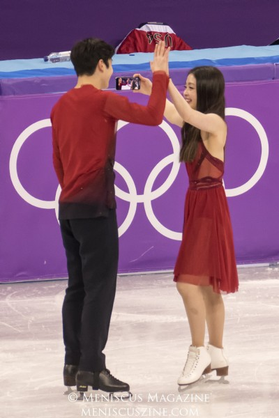 Alex (left) and Maia Shibutani congratulate each other - and prepare for more social media footage - at the Venue Ceremony honoring the Olympic ice dance medalists at Gangneung Ice Arena.