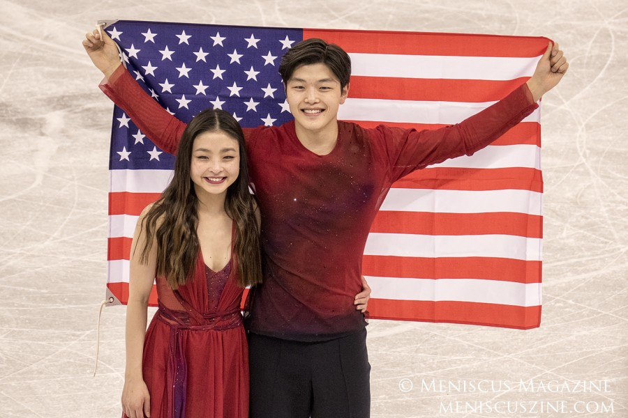 """Maia (left) and Alex Shibutani proudly display the U.S. flag at the PyeongChang 2018 ice dance Venue Ceremony. Unlike her brother, Maia tweeted just three words after winning two bronze medals: """"WE DID IT!!!"""""""