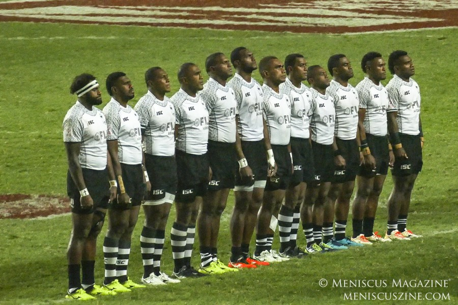 Team Fiji stands for the national anthems before the start of the championship match against Kenya. (photo by Yuan-Kwan Chan / Meniscus Magazine)