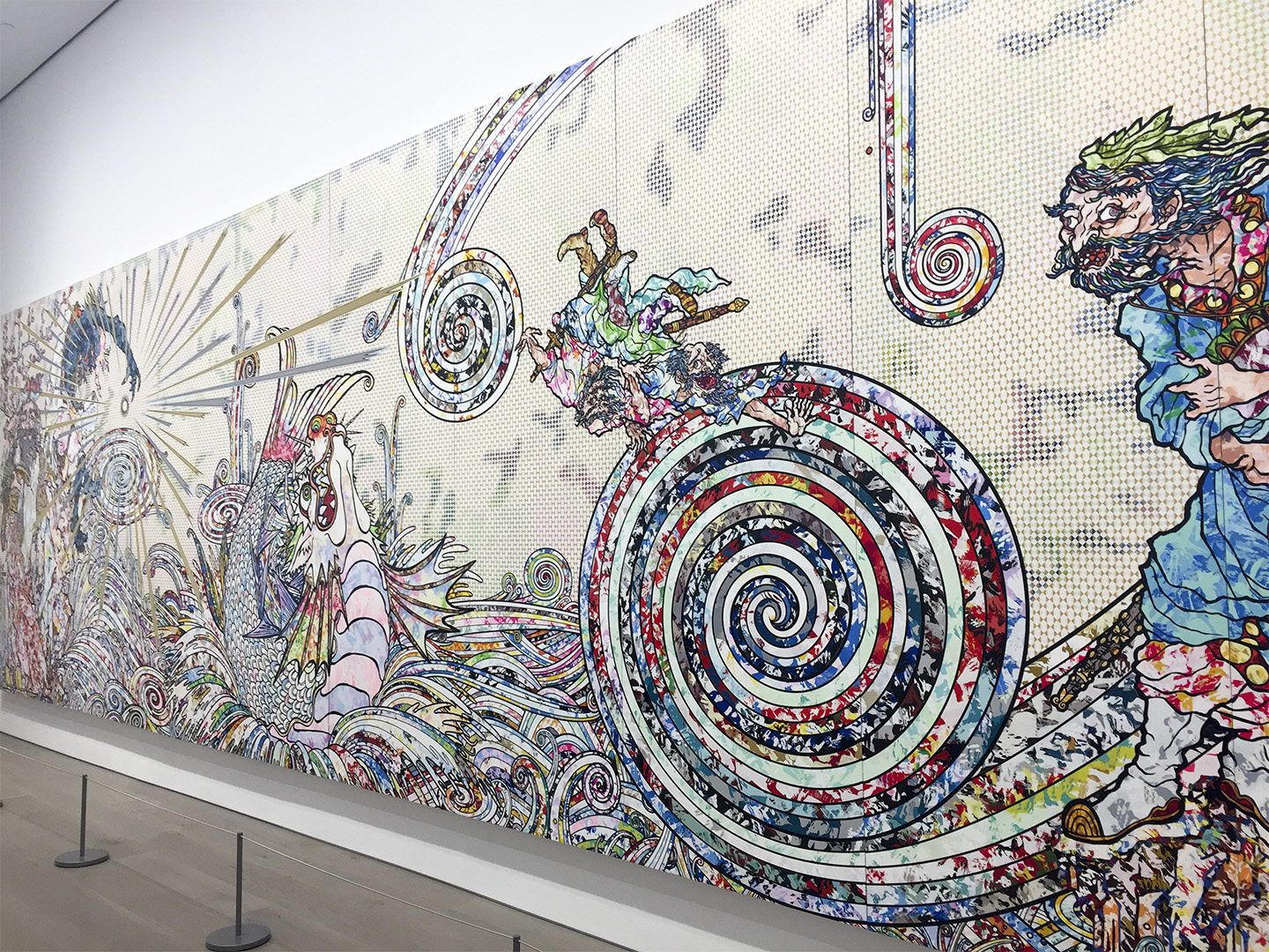 "A portion of Takashi Murakami's ""Transcendent Attacking a Whirlwind"" (2017). Acrylic, gold leaf, and platinum leaf on canvas mounted on wood panel, 300 x 1000 cm (10 panels) photo by Megan Lee / Meniscus Magazine)"
