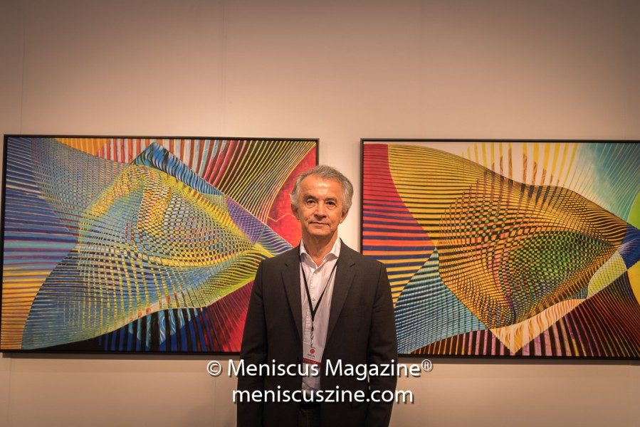 "The artist Manss Aval poses with his work titled ""Hai"" (2016). Oil on canvas 48 × 72 × 2 in; 121.9 × 182.9 × 5.1 cm (photo by Ali Zandi / Meniscus Magazine)"