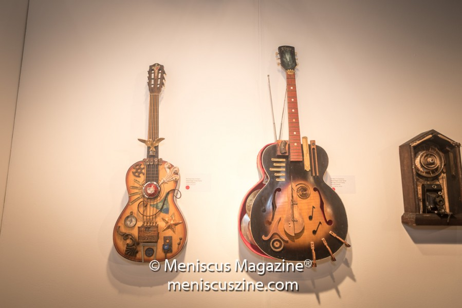 "(left) Artist: Victoria Roberts Running Down A Dream Guitar Art inspired by the song by Tom Petty (center) Artist: Victoria Roberts I've Been to Graceland Assemblage/Mixed Media, 41""h x 20""w x 6""d (right) Artist: Victoria Roberts Rust Never Sleeps Assemblage/Mixed Media, 18""h x 10""w x 5""d (photo by Ali Zandi / Meniscus Magazine)"