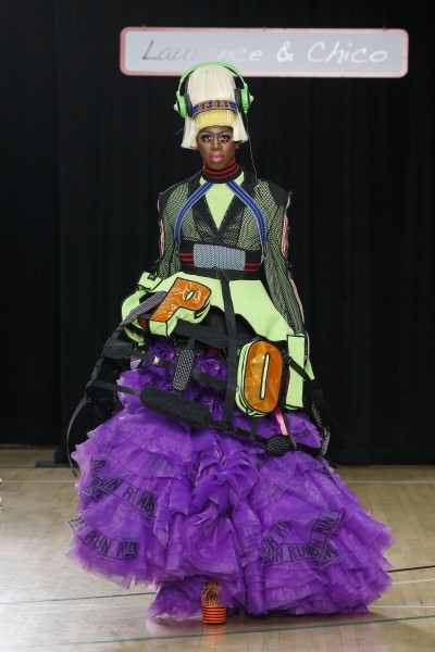 "Miss J Alexander models a Black Mesh Blazer; Long Purple Tulle Skirt; and Green & Orange ""SPORT"" Cage. (photo by Dan Lecca)"