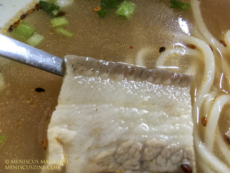 You know you have black pork in your noodles when you see fine black hairs in the top layer of the skin (these aren't detectable when consumed). (photo by Yuan-Kwan Chan / Meniscus Magazine)