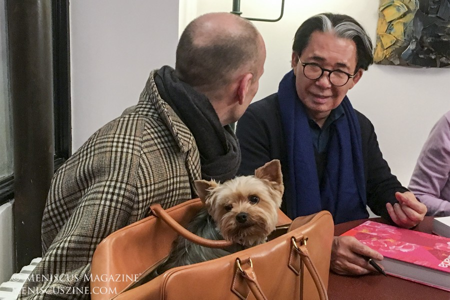 Kenzo Takada signs a copy of his namesake book for a fan on Mar. 2, 2019, in Paris The books sold out early in the evening, prompting the designer to confirm with bookstore staff that there weren't any left. (photo by Yuan-Kwan Chan / Meniscus Magazine)