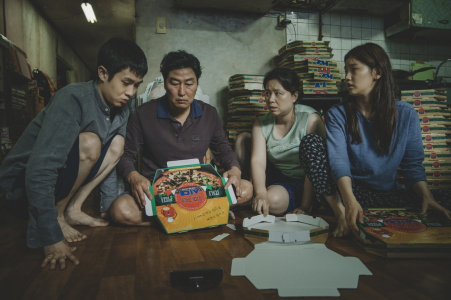 """(left to right) Choi Woo-shik, Song Kang-ho, Jang Hye-jin and Park So Dam play a family trying to make ends meet in """"Parasite."""" (still courtesy of the Busan International Film Festival)"""