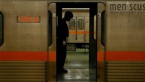 "Busan Metro worker Um Woochul (엄우철) testing the doors of a train car before resuming operation in ""Underground."" In a post-screening Q&A session on Oct. 9, 2019, in Busan, he said that this was the most visually interesting scene featuring himself in the film. (still courtesy of the Busan International Film Festival)"