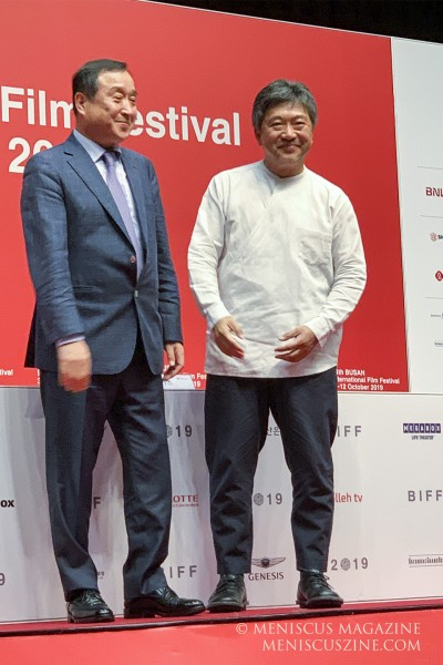 Jay Jeon (left), the Busan International Film Festival director, with Hirokazu Kore-eda at the Shinsegae Culture Hall in Busan on Oct. 5, 2019. (photo by Wade-Hahn Chan / Meniscus Magazine)
